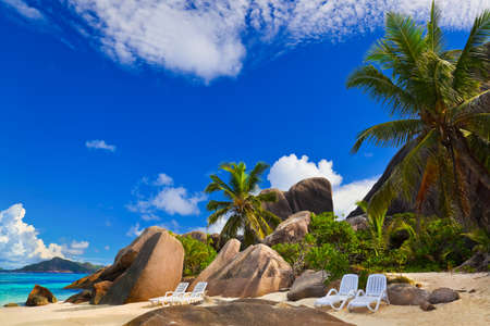 Chairs on tropical beach at Seychelles - vacation background photo