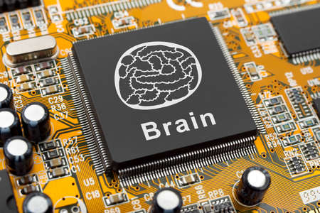 cybernetic: Brain symbol on computer chip - technology concept Stock Photo