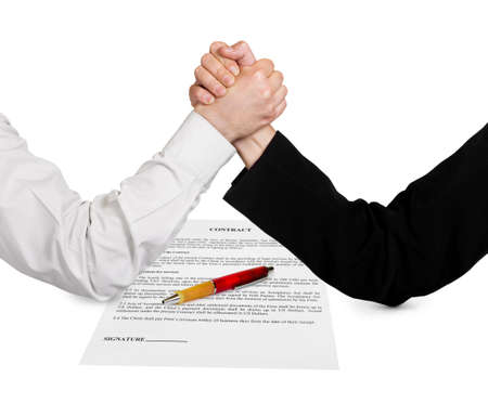 Two wrestling hands and contract isolated on white background photo