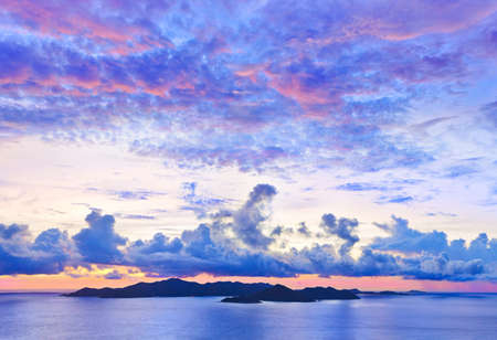 vue: Island Praslin at sunset - nature background Stock Photo