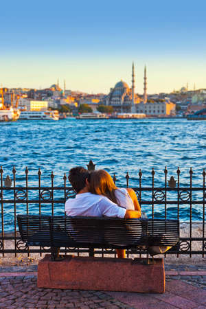 istanbul: Man and woman on bench at Istanbul Turkey - love background