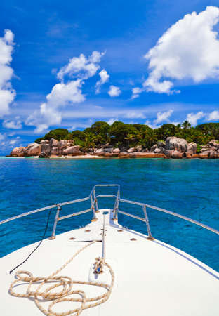 Tropical island and boat - nature background photo