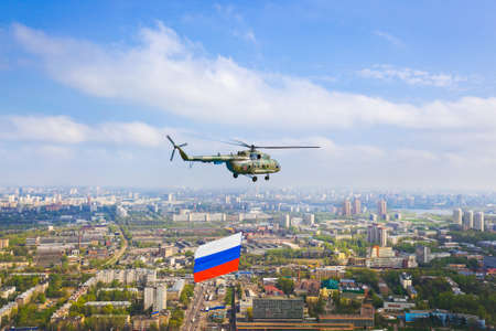 Helicopter with russian flag over Moscow at parade of victory day - aerial view photo