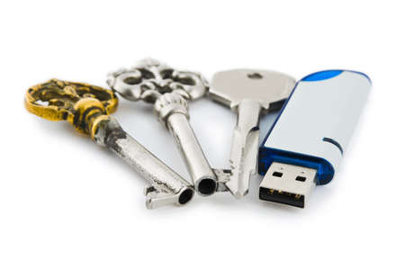 microdrive: Retro keys and computer flash drive isolated on white background