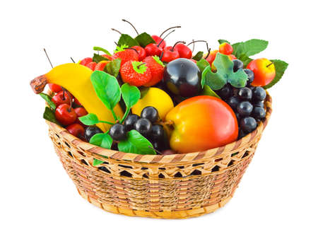 Basket with fruits (artificial) isolated on white background photo