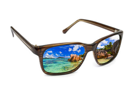 Sunglasses and seascape reflection isolated on white background photo
