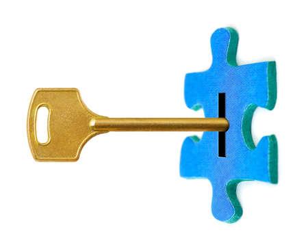 Key and puzzle isolated on white background photo
