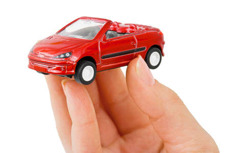 Hand and toy car isolated on white background photo