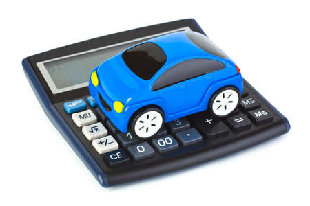 Calculator and toy car isolated on white background Stock Photo - 11979073