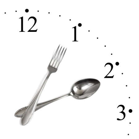 regimen: Clock made of spoon and fork isolated on white background