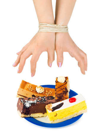 woman tied: Cakes and bound hands isolated on white background Stock Photo