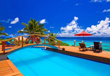Pool at tropical beach - vacation background photo