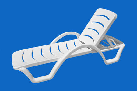 Beach chair isolated on blue background photo