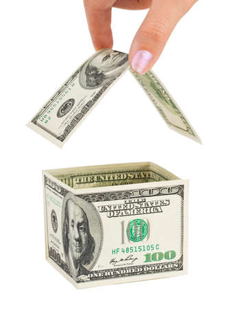 Hand and money house isolated on white background photo
