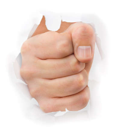 Fist punching paper isolated on white background Stock Photo - 12033496