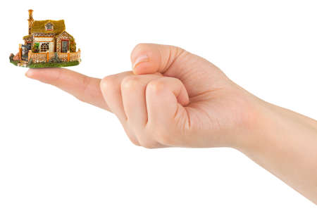 Hand and small house isolated on white background Stock Photo - 12033506
