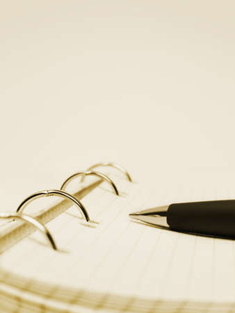 Pen and notepad - abstract business background photo