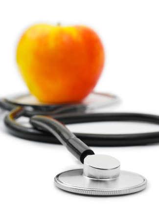 otoscope: Medical stethoscope and apple isolated on white background