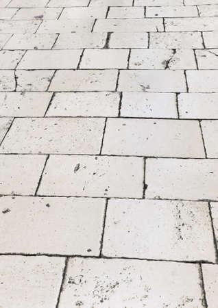 Retro tiled floor on street at Croatia - architecture background photo