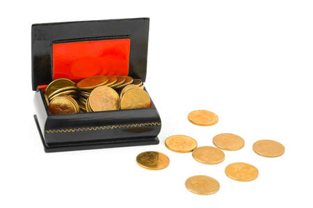 Gold coins in box isolated on white background photo