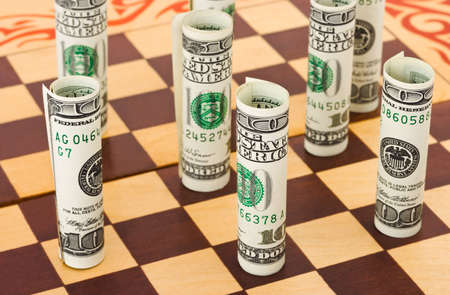 Money on chess board business concept background photo