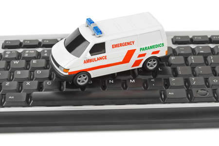 doctor toys: Computer keyboard and medical car - technology background