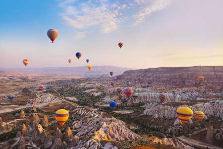 hot air ballon: Hot air balloon flying over rock landscape at Cappadocia Turkey Stock Photo