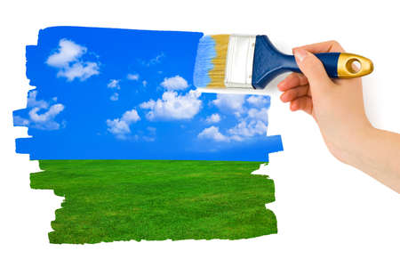 Hand with paintbrush drawing landscape isolated on white background Stock Photo - 12322394