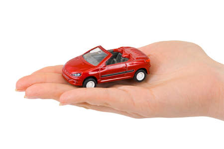 Hand and toy car isolated on white background Stock Photo - 12322705