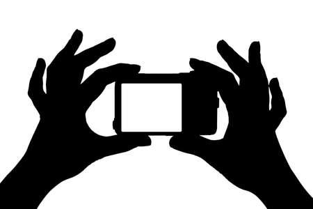 při pohledu na fotoaparát: Kamera v rukou izolovaných na bílém pozadí