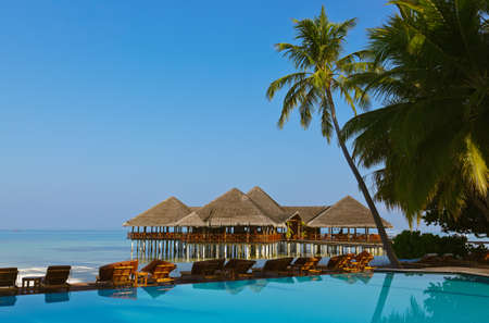 Water cafe and pool - Maldives vacation background Stock Photo - 12279798