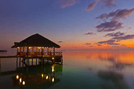 Water cafe at sunset - Maldives vacation background photo