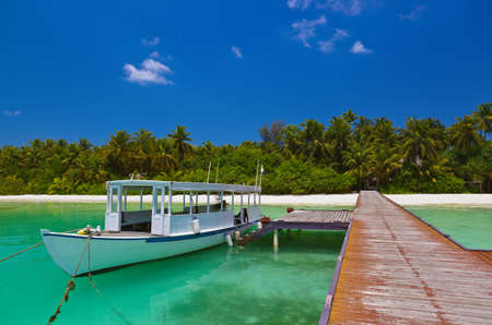Tropical island and boat - nature travel background Stock Photo