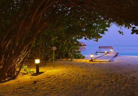 Jetty beach at sunset - Maldives vacation background photo