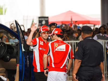 gp: SEPANG, MALAYSIA - APRIL 10: Fernando Alonso and Felipe Massa (Ferrari) greet fans at the  autograph session on Formula 1 GP, April 10 2011, Sepang, Malaysia Editorial