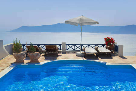 hotel balcony: Water pool at Santorini, Greece - vacation background