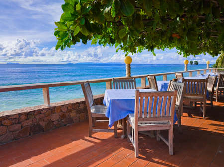 Cafe on tropical beach - travel background photo