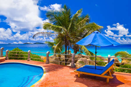 Pool at tropical beach - vacation background Stock Photo
