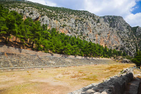 Ruins of stadium in Delphi, Greece - archaeology background photo