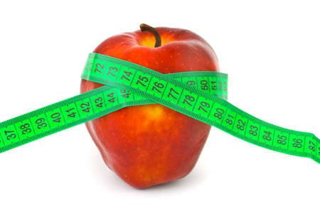 Apple and measuring tape isolated on white background photo