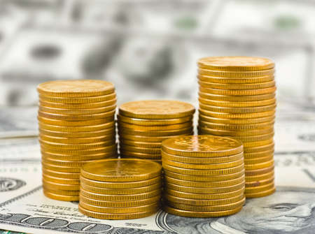 Stacks of coins on money - abstract business background photo