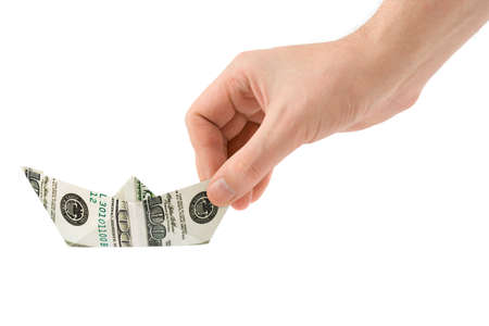 Hand with money ship isolated on white background photo