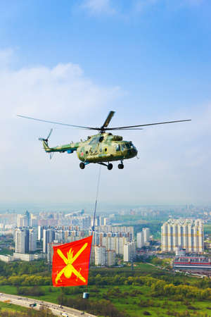 Helicopter with military flag over Moscow at parade of victory day - aerial view