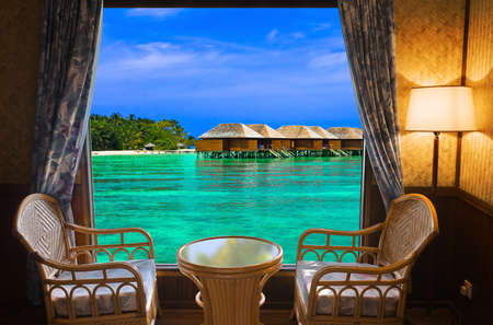 Hotel room and tropical landscape - vacation concept background photo