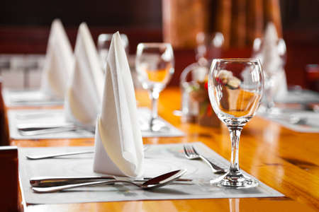 business dinner: Glasses and plates on table in restaurant - food background