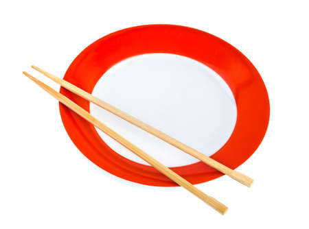 Plate and chopsticks isolated on white background photo