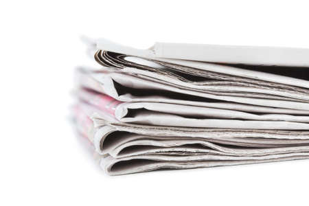 Stack of newspapers isolated on white background Stock Photo - 12907057