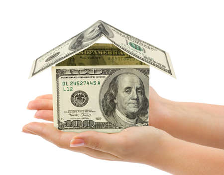 Hands and money house isolated on white background Stock Photo - 12986698