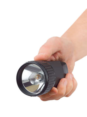 Flashlight in hand isolated on white background photo