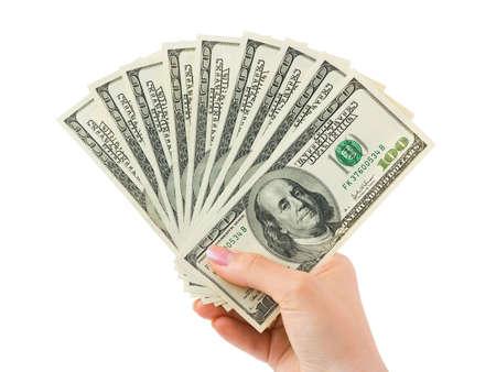 dare soldi: Mano con i soldi isolato su sfondo bianco